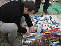 Toni Petrovic rummaging through photos at the flea market