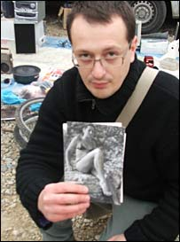 Toni holding one photo at the flea market