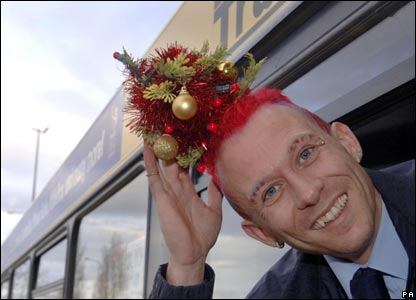 Bus diver Mark Davis, 31, with mini-Christmas tree in his hair