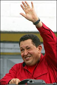 Venezuelan President Huge Chavez greets supporters after voting