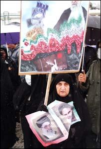 An elderly woman at Iran's 25th anniversary of its Islamic revolution