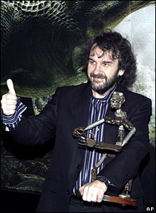 King Kong director Peter Jackson holds a stop-motion skeleton used for the original King Kong