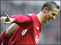 Peter Crouch celebrates scoring against Wigan