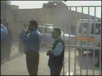 Policemen stand outside the academy in east Baghdad