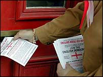 Garry Bushell puts a leaflet through a door