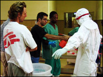 Experts from Medecins Sans Frontieres help train volunteers in a hospital in Luanda