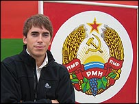 Simon Reeve in front of the Transdniestrian flag in the capital, Tiraspol