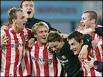 Sunderland players celebrate after their win over West Ham which secured the Championship title