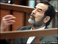 Saddam gesticulates at his trial
