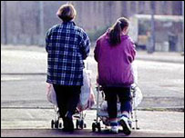 Young mums pushing prams