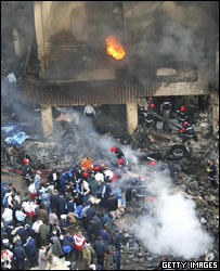 Rescuers in burning building