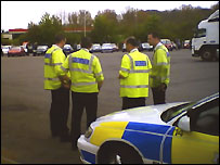 Police prepare to escort a 'go-slow' protest on the M4