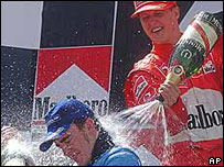 Michael Schumacher (arriba) y Fernando Alonso.
