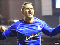 Peter Lovenkrands celebrates his equaliser