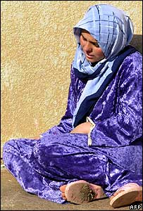 Woman grieves for sister killed in a gun attack in Kirkuk