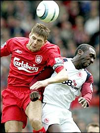 Reds skipper Steven Gerrard (left) rises above Jimmy Floyd Hasselbaink to win a header at Anfield