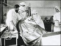 Dr Eduard Zirm operating on a patient