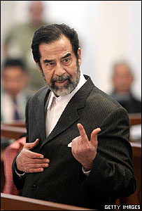 Saddam gesticulates at trial