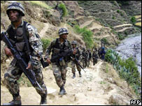 Nepalese soldiers patrol in the Rolpa district in an operation against Maoist rebels.
