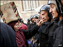 An Egyptian woman talks to soldiers who have blocked access to a polling station in Zagazig in Egypt's Nile Delta