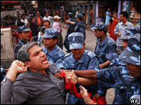 Police detain activists of the Nepal Communist Party during an anti-King Gyanendra demonstration in Kathmandu, Nepal