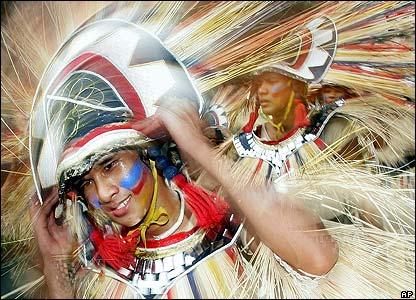 Filipino dancers join a parade in Makati, south of Manila.