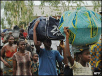 Togolese arrive seeking refuge in a church at Hilla-Condji in neighbouring Benin.