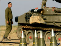 An Israeli soldier with artillery equipment just outside the Gaza Strip