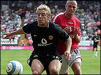 Man Utd's Alan Smith and Charlton's Paul Konchesky
