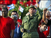 Fidel Castro watches the crowds gathered for Labour Day