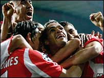 Bencifa's Beto (centre) celebrates scoring with his team-mates
