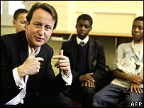 Mr Cameron talks to boys from the Eastside Young Leaders' Academy 