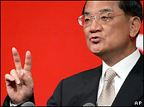 Taiwan's Nationalist Party Chairman Lien Chan gestures as he speaks to Taiwanese businessmen in Shanghai, China, Monday, May 2, 2005.