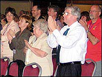 Delegates give standing ovation after the speech