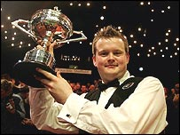 Shaun Murphy celebrates winning the world snooker title