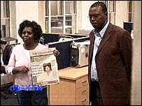 Lucy Kibaki at the Nation Media Group offices and Nairobi Provincial Police Officer King'ori Mwangi.