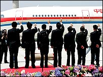 Chinese officials send off the plane carrying Taiwan's Nationalist Party Chairman Lien Chan and his delegation at Pudong airport in Shanghai, China, 03 May 2005