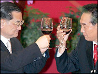 Taiwan's Nationalist Party Chairman Lien Chan, left, toasts with Taiwan Affairs Office Director Chen Yunlin during a banquet in Shanghai, China, Monday, May 2, 2005.