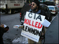 Man with CIA Killed Lennon banner
