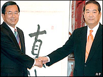 Taiwanese President Chen Shui-bian, left, shakes hands with People First Party Chairman James Soong at the beginning of an inter party meeting, Thursday, Feb. 24, 2005, in Taipei