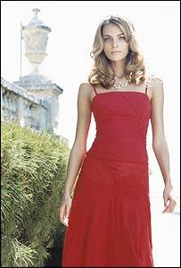 Model wearing Coast red dress