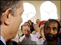 Tony Blair is confronted by Mohamed Jaffer in Gloucester