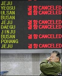 An airport board shows cancelled Korean Air flights