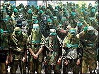 Hamas militants perform prayers in Gaza
