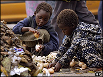 Children savaging for food at a rubbish dump outside Harare