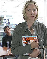 Woman holding Glamour magazine
