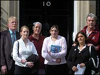 Relatives of servicemen killed in Iraq hand in a letter at Downing Street