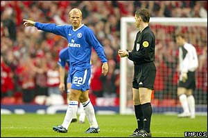 Chelsea's Eidur Gudjohnsen complains vehemently to referee Lubos Michel