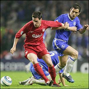 Liverpool's Steve Finnan protects the ball