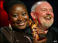 South African actress Pauline Malefane (l) and director Mark Dronford-May pose with the Golden Bear award at the 55th Berlinale International Film Festival